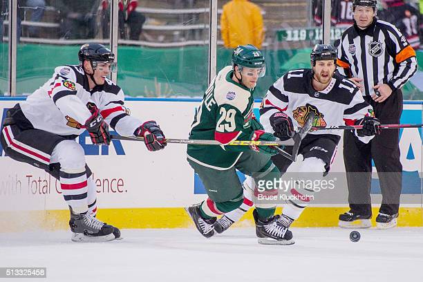 Viktor Svedberg and Andrew Desjardins of the Chicago Blackhawks skate to a loose puck against Jason Pominville of the Minnesota Wild during the 2016...