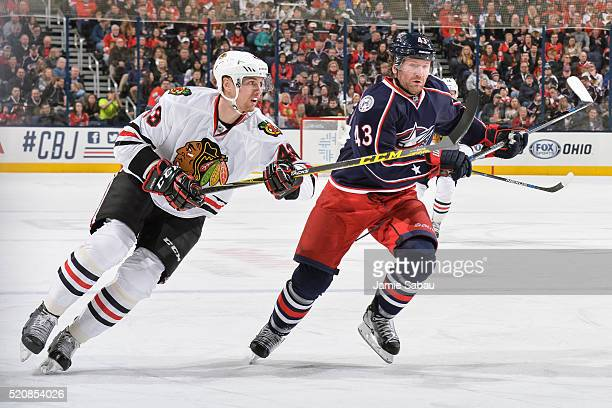 Viktor Svedberg of the Chicago Blackhawks and Scott Hartnell of the Columbus Blue Jackets chase after a loose puck on April 9 2016 at Nationwide...