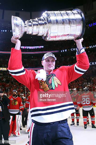 Viktor Svedberg of the Chicago Blackhawks celebrates by hoisting the Stanley Cup after defeating the Tampa Bay Lightning by a score of 20 in Game Six...