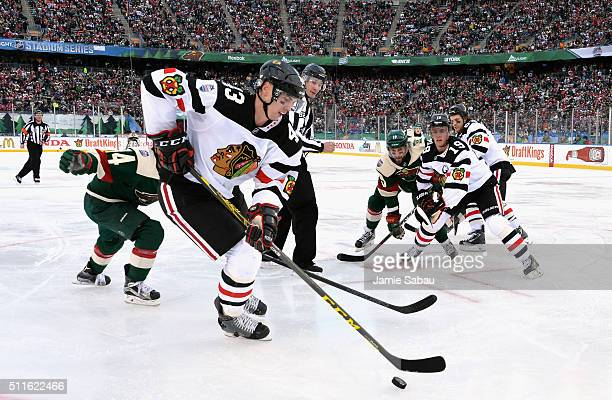 Viktor Svedberg of the Chicago Blackhawks controls the puck after after a faceoff during the the 2016 Coors Light Stadium Series game against the...