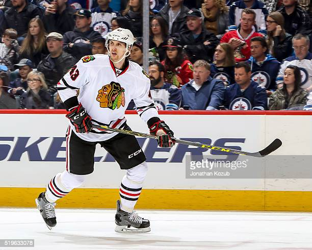 Viktor Svedberg of the Chicago Blackhawks keeps an eye on the play during third period action against the Winnipeg Jets at the MTS Centre on April 1...