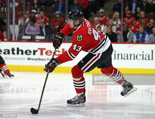 Viktor Svedberg of the Chicago Blackhawks passes against the Anaheim Ducks at the United Center on October 26 2015 in Chicago Illinois The Blackhawks...
