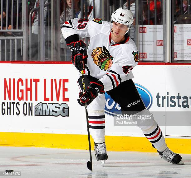 Viktor Svedberg of the Chicago Blackhawks passes in an NHL hockey game against the New Jersey Devils at Prudential Center on November 6 2015 in...