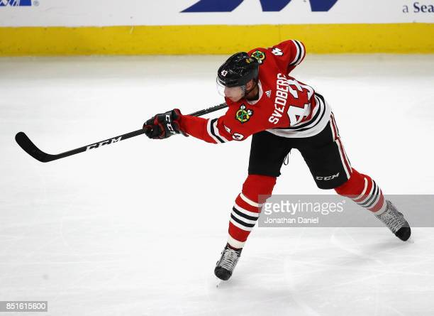 Viktor Svedberg of the Chicago Blackhawks shoots against the Detroit Red Wings during a preseason game at the United Center on September 21 2017 in...