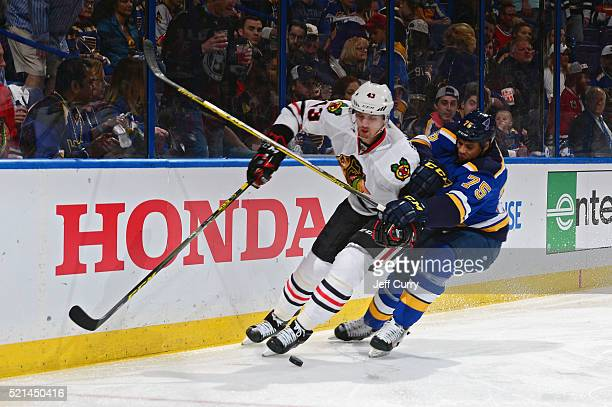 Viktor Svedberg of the Chicago Blackhawks skates against Ryan Reaves of the St Louis Blues in Game Two of the Western Conference Quarterfinals during...
