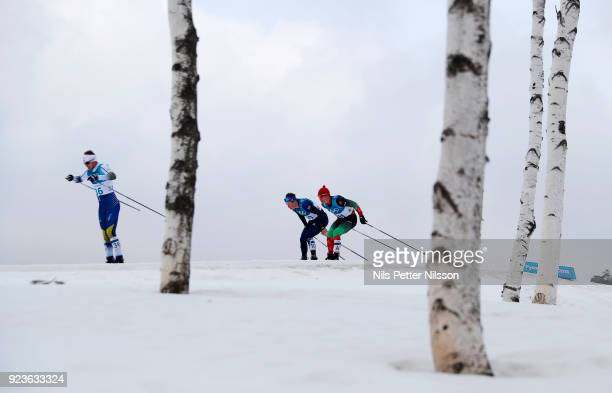 Viktor Thorn of Sweden Andrew Musgrave of Great Britain and Michail Semenov of Belarus competes during the Mens 50k Classic competition at Alpensia...