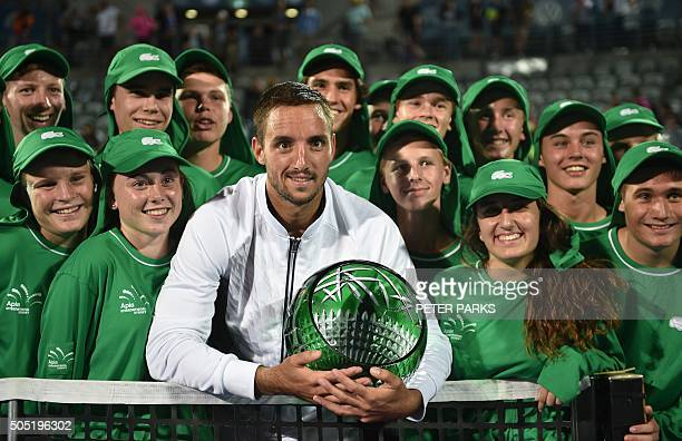 Viktor Trioicki of Serbia hold the winners trophy with the ballkids after beating Grigor Dimitrov of Bulgaria 26 61 76 in the men's singles final...