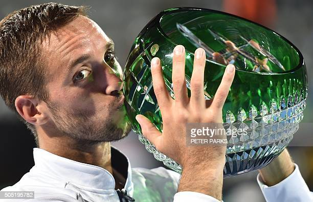 Viktor Trioicki of Serbia kisses the trophy after beating Grigor Dimitrov of Bulgaria 26 61 76 in the men's singles final match at the Sydney...