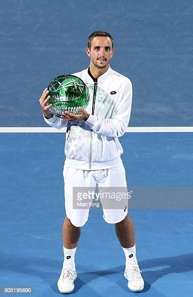 Viktor Troicki of Serbia celebrates and holds aloft the winners trophy after winning the men's final match against Grigor Dimitrov of Bulgaria during...
