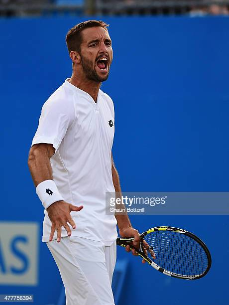 Viktor Troicki of Serbia celebrates in his men's singles quarterfinal match against John Isner of USA during day five of the Aegon Championships at...