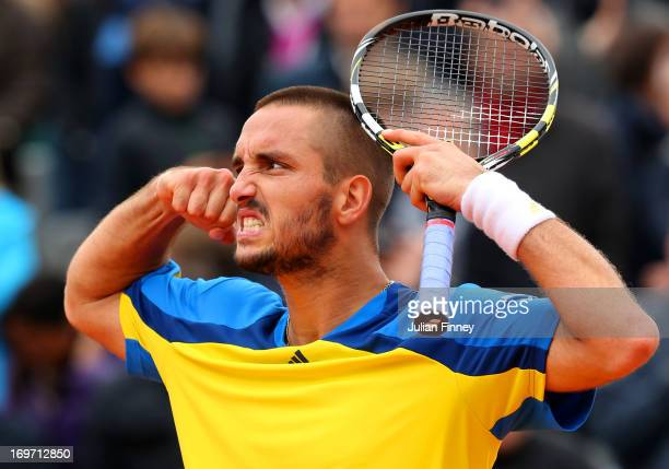 Viktor Troicki of Serbia celebrates match point during his Men's Singles match against Marin Cilic of Croatia on day six of the French Open at Roland...
