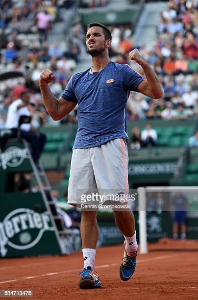 Viktor Troicki of Serbia celebrates victory during the Men's Singles third round match against Gilles Simon of France on day six of the 2016 French...