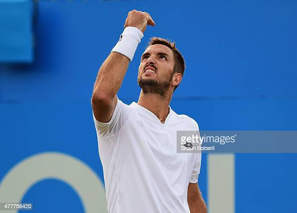 Viktor Troicki of Serbia celebrates victory in his men's singles quarterfinal match against John Isner of USA during day five of the Aegon...