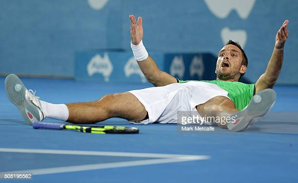 Viktor Troicki of Serbia celebrates winning championship point in his men's final match against Grigor Dimitrov of Bulgaria during day seven of the...