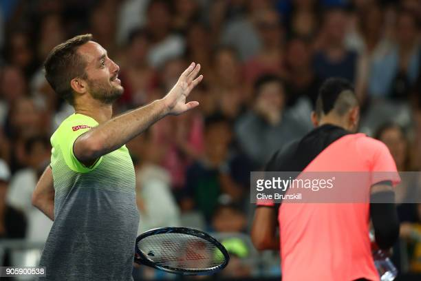 Viktor Troicki of Serbia checks to see if the chair umpire is ok after playing a shot which hit him in his second round match against Nick Kyrgios of...