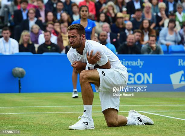 Viktor Troicki of Serbia grimaces after a fall in his men's singles semifinal match against Andy Murray of Great Britain during day six of the Aegon...