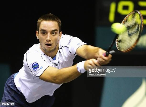 Viktor Troicki of Serbia hits a backhand during his match against John Isner of the USA during day seven of the 2009 Thailand Open at Impact Arena on...
