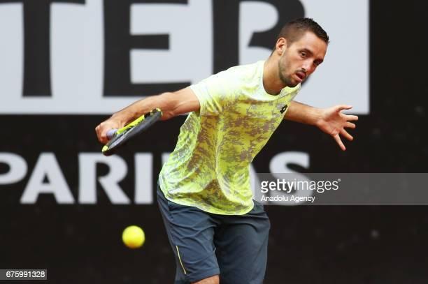 Viktor Troicki of Serbia is in action against Greek Cypriot Marcos Baghdatis during their TEB BNP Paribas Istanbul Cup Men's tennis match at Garanti...
