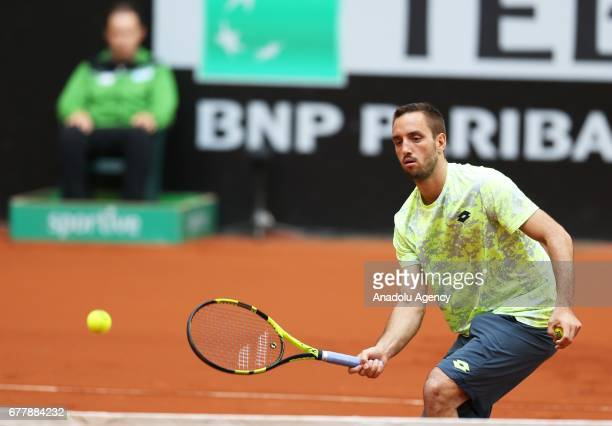 Viktor Troicki of Serbia is in action against Greek Cypriot Marcos Baghdatis during their TEB BNP Paribas Istanbul Open Men's tennis match at Garanti...