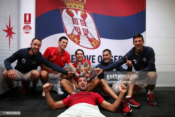 Viktor Troicki of Serbia Novak Djokovic of Serbia and team mates pose in their changeroom after winning the ATP Cup final against Spain during day 10...