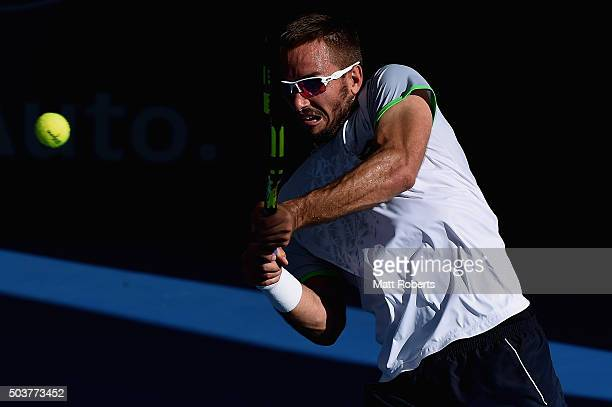 Viktor Troicki of Serbia plays a backhand against David Goffin of Bulgaria during day five of the 2016 Brisbane International at Pat Rafter Arena on...