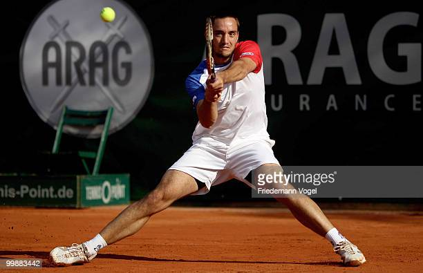 Viktor Troicki of Serbia plays a backhand during his match against Jeremy Chardy of France during day three of the ARAG World Team Cup at the...