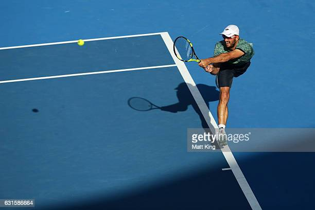 Viktor Troicki of Serbia plays a backhand in his semi final match against Giles Muller of Luxembourg during the Sydney International at Sydney...