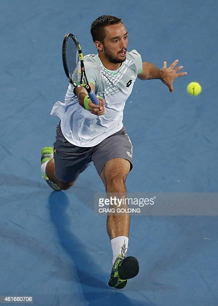 Viktor Troicki of Serbia plays a forehand against Mikhail Kukushkin of Kazakhstan during the men's singles final on day seven of the Sydney...