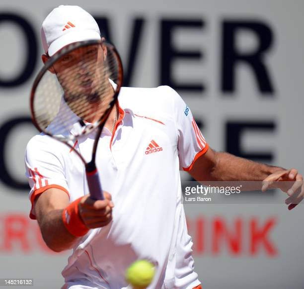 Viktor Troicki of Serbia plays a forehand during his match against Florian Mayer of Germany during day five of Power Horse World Team Cup at...