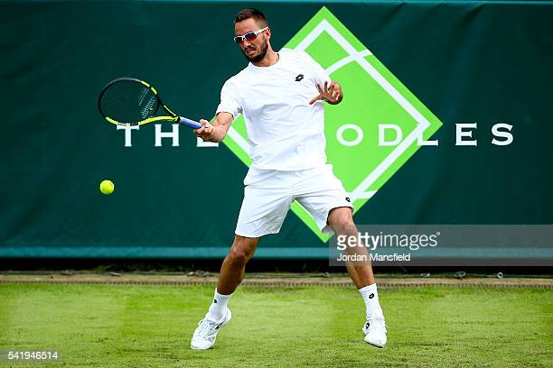 Viktor Troicki of Serbia plays a forehand during his match against Jeremy Chardy of France during day one of The Boodles Tennis Event at Stoke Park...