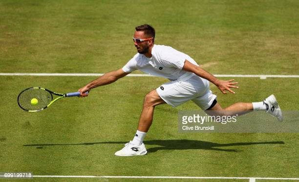Viktor Troicki of Serbia plays a forehand during mens singles second round match against Donald Young of The United States on day three of the 2017...
