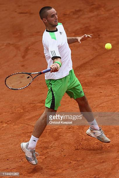 Viktor Troicki of Serbia plays a forehand during the blue group match between Viktor Troicki of Serbia and Marcel Granollers of Spain during day five...