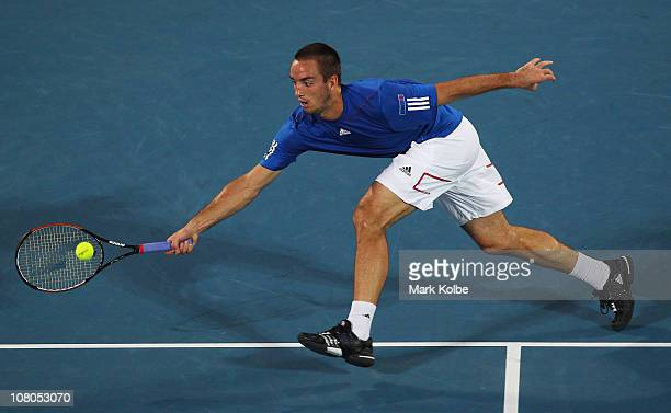Viktor Troicki of Serbia plays a forehand in the men's final match against Gilles Simon of France during day seven of the 2011 Medibank International...