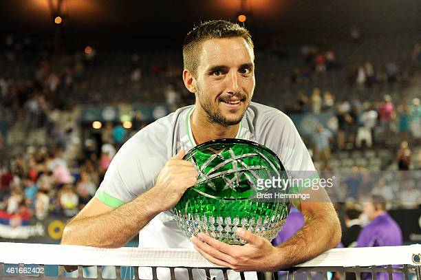 Viktor Troicki of Serbia poses for a photo with the APIA International Trophy after victory in the Men's Singles Final match against Mikhail...