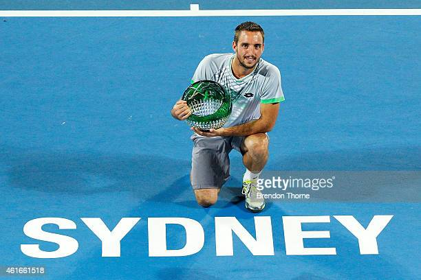 Viktor Troicki of Serbia poses with the winners trophy following the Men's Singles Final match against Mikhail Kukushkin of Kazakhstan during day...