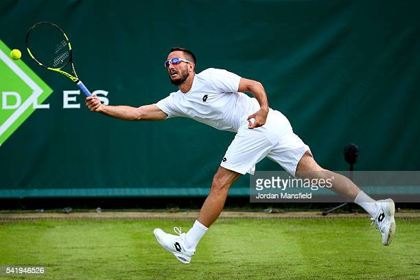 Viktor Troicki of Serbia reaches for a forehand during his match against Jeremy Chardy of France during day one of The Boodles Tennis Event at Stoke...