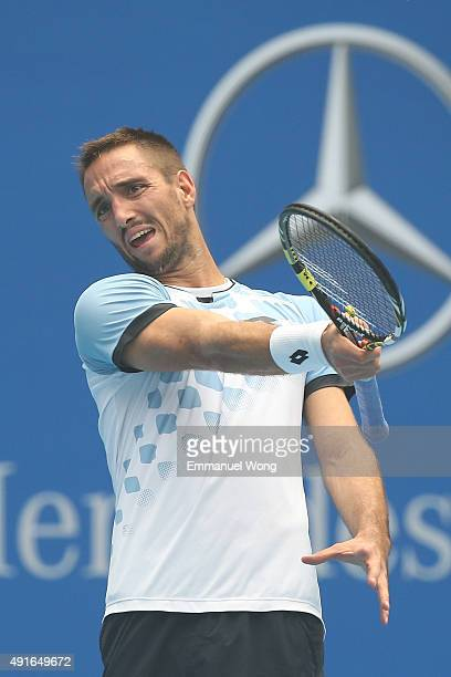 Viktor Troicki of Serbia reacts during the match against YenHsun Lu of Taipei during the day five of the 2015 China Open at the China National Tennis...
