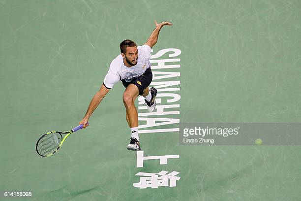 Viktor Troicki of Serbia returns a shot against Rafael Nadal of Spain during the Men's singles second round match on day four of Shanghai Rolex...