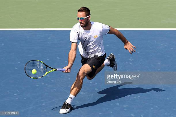 Viktor Troicki of Serbia returns a shot during the semi final match against Karen Khachanov of Russia during Day 6 of 2016 ATP Chengdu Open at...