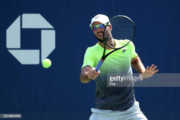 Viktor Troicki of Serbia returns the ball during his men's singles first round match against Tennys Sandgren of the United States on Day Two of the...