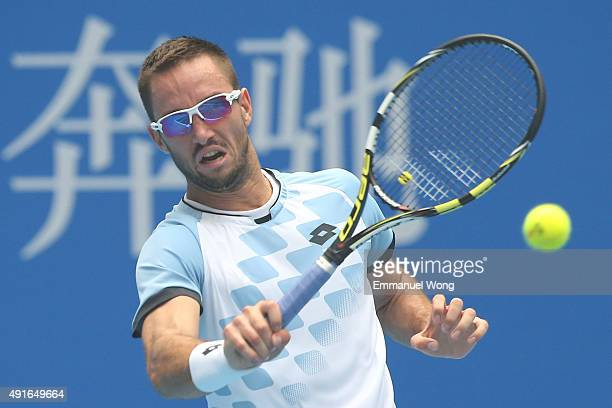 Viktor Troicki of Serbia rturns a ball against YenHsun Lu of Taipei during the day five of the 2015 China Open at the China National Tennis Center on...