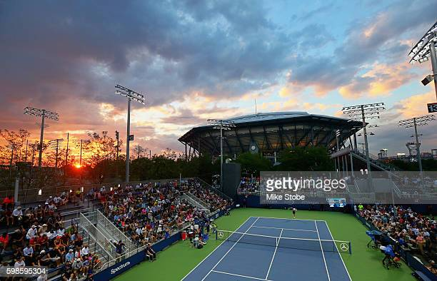 Viktor Troicki of Serbia serves against Jared Donaldson of the United States in their second round Men's Singles match on Day Four of the 2016 US...