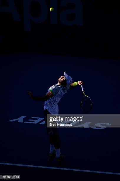 Viktor Troicki of Serbia serves in his semi final match against Gilles Muller of Luxembourg during day six of the 2015 Sydney International at Sydney...