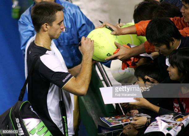 Viktor Troicki of Serbia signs autographs after the win over JoWilfried Tsonga of France on day four of the AIG Japan Open Tennis Championship 2008...