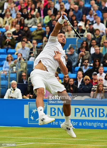 Viktor Troicki of Serbia smashes in his men's singles semifinal match against Andy Murray of Great Britain during day six of the Aegon Championships...