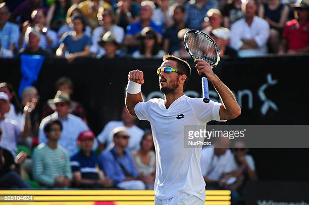 Viktor Troicki raises hands after winning in the Mercedes Cup semifinals against the US Open champion Marin Cilic with 63 67 76 in Stuttgart on June...