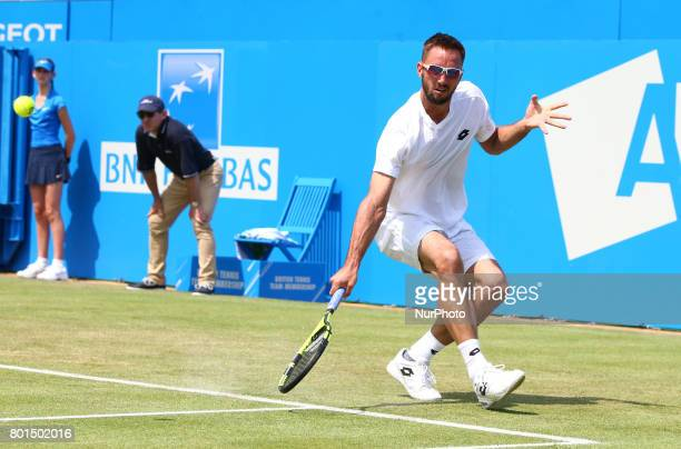 Viktor Troicki SRB ageinst Donald Young during Round Two match on the third day of the ATP Aegon Championships at the Queen's Club in west London on...