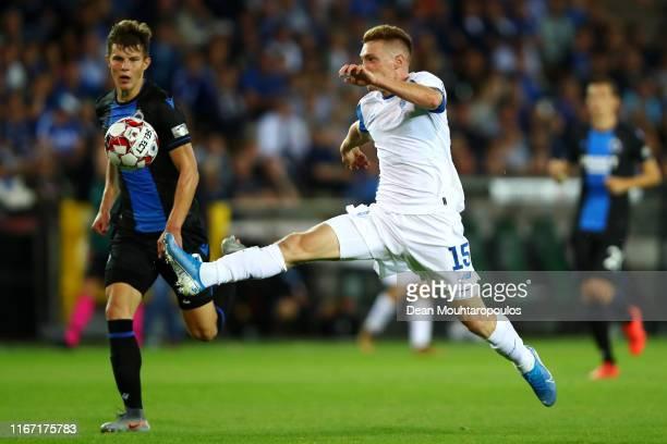 Viktor Tsygankov of Football Club Dynamo Kyiv battles for the ball with Eduard Sobol of Club Brugge KV during the UEFA Champions League, Third...