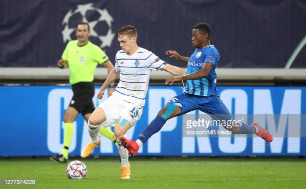 Viktor Tsygankov of Kyiv battles for the ball with Nurio Fortuna of KAA Gent during the UEFA Champions League PlayOff first leg match between KAA...