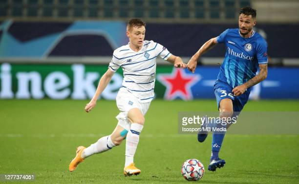 Viktor Tsygankov of Kyiv battles for the ball with Tim Kleindienst of KAA Gent during the UEFA Champions League PlayOff first leg match between KAA...